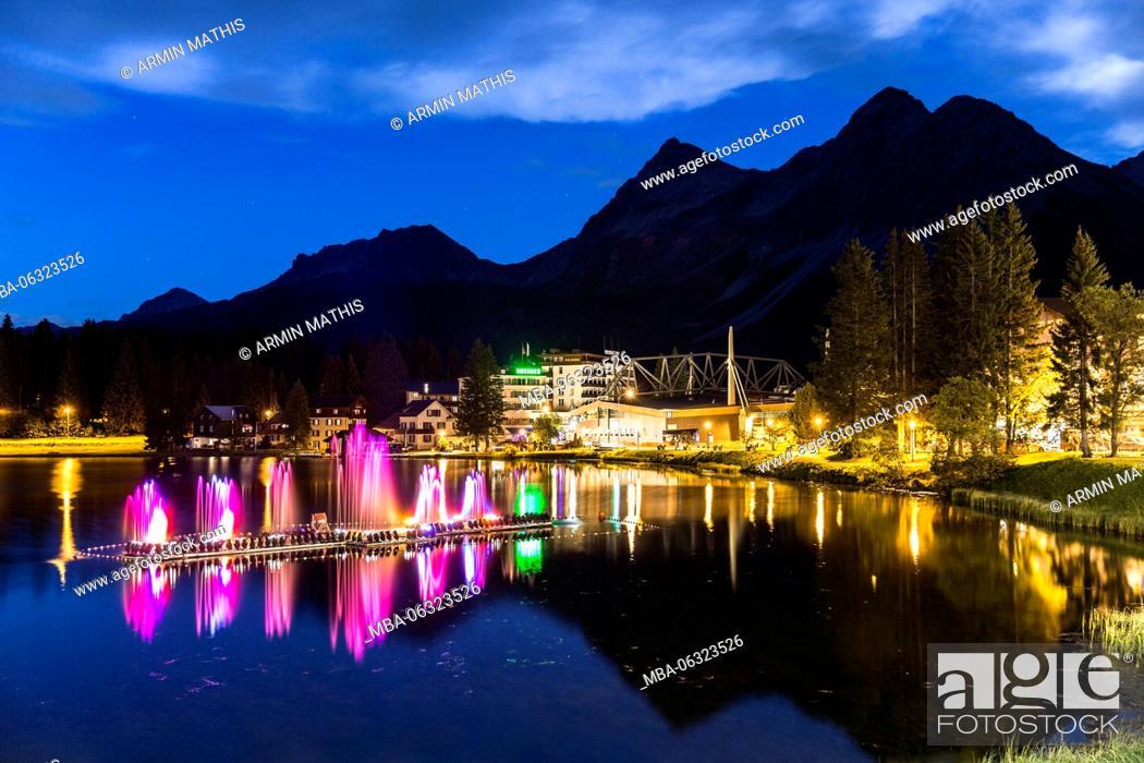 Stock Photo: Light show on the lake at Arosa.