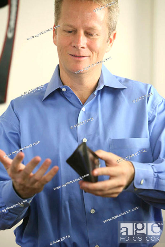 Stock Photo: Close-up of a mid adult man holding a wallet.