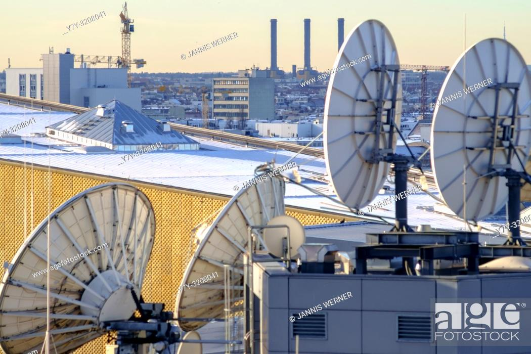 Stock Photo: Satellite dishes over Potsdamer Platz with the Staatsbibliothek in the background in Berlin, Germany.