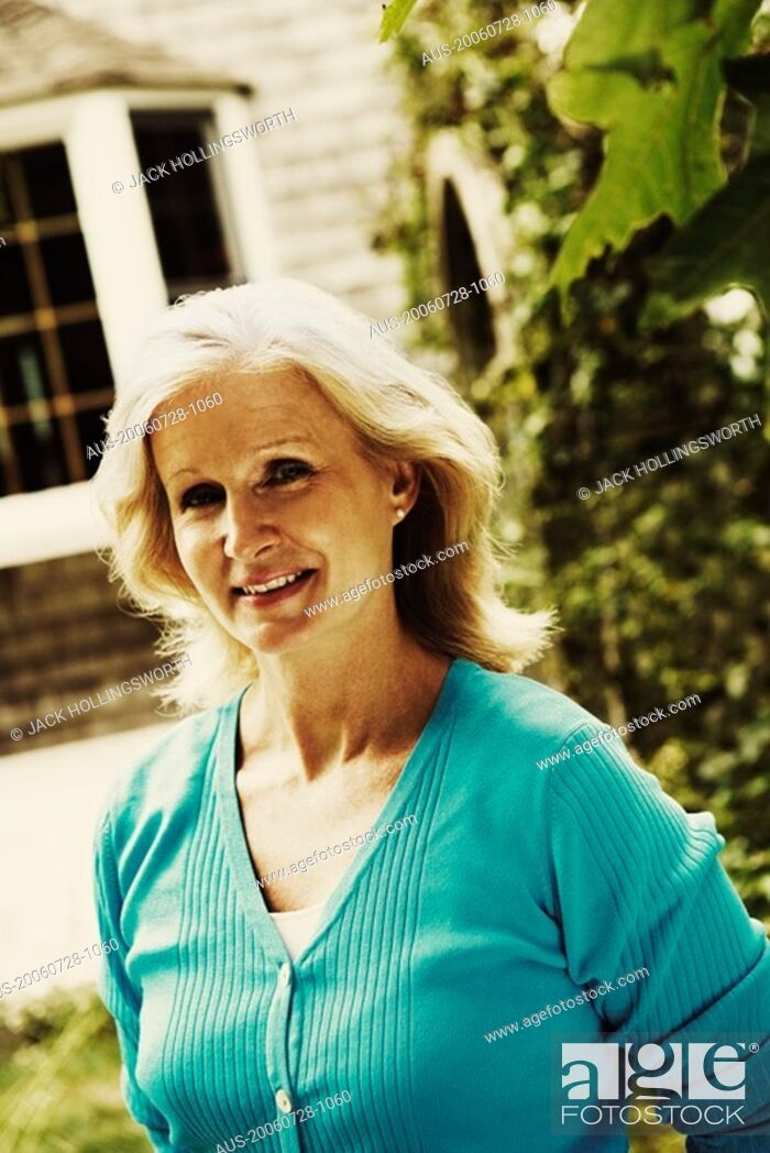 Stock Photo: Portrait of a mature woman smiling.