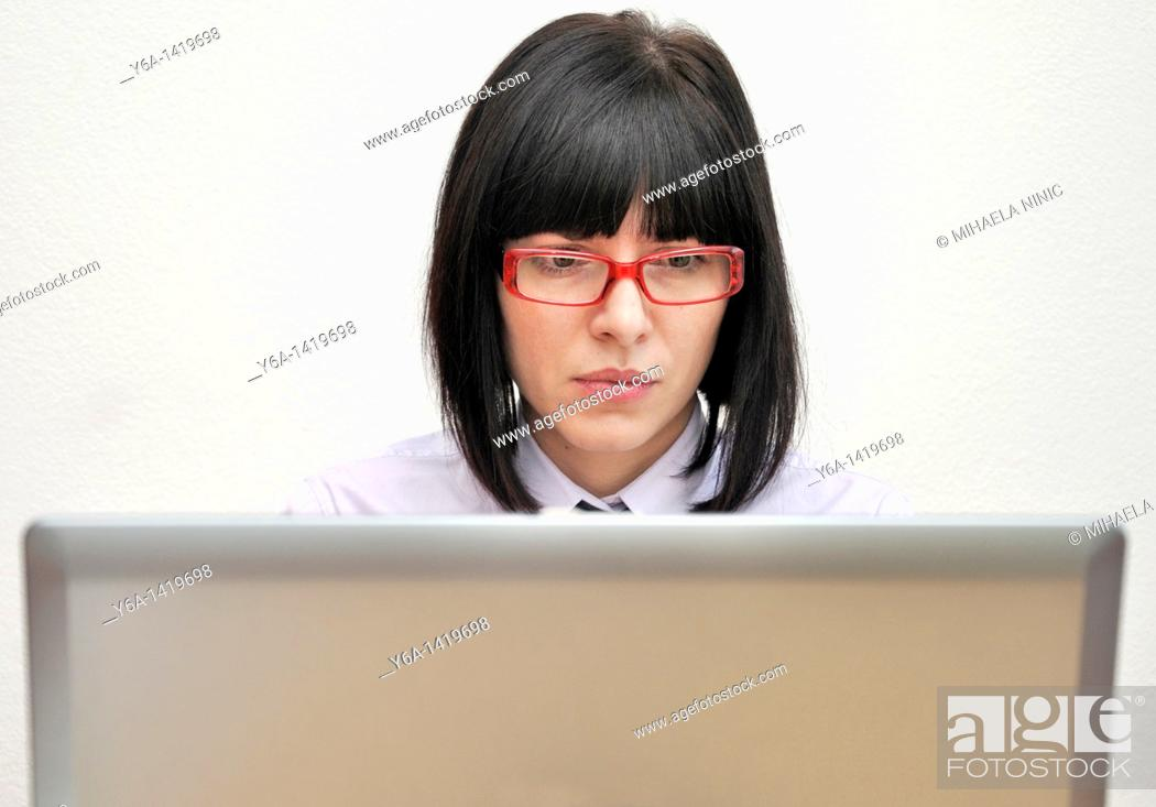 Stock Photo: Young businesswoman using laptop.