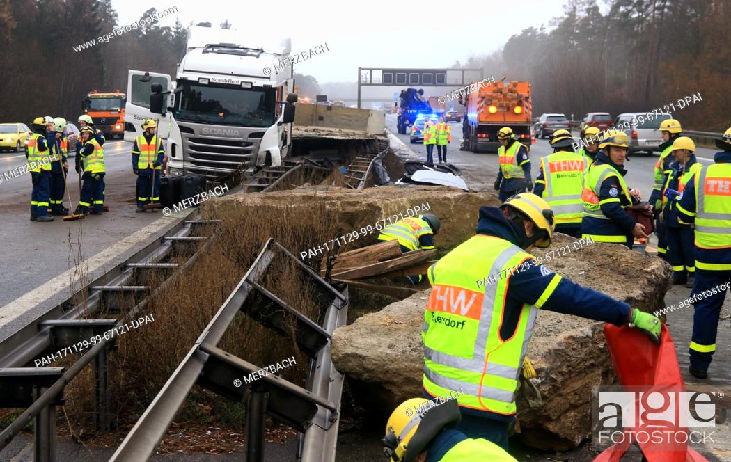 Emergency relief forces work on an accident site on motorway A3 near