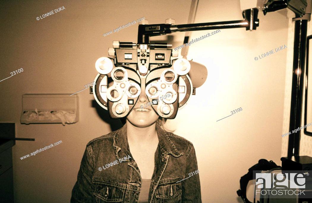 Stock Photo: Teen girl eye exam.