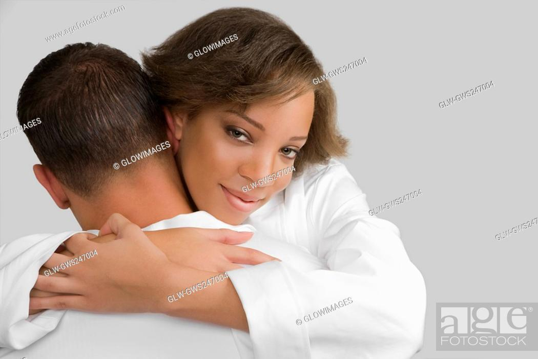 Stock Photo: Close-up of a young woman embracing a mid adult man.