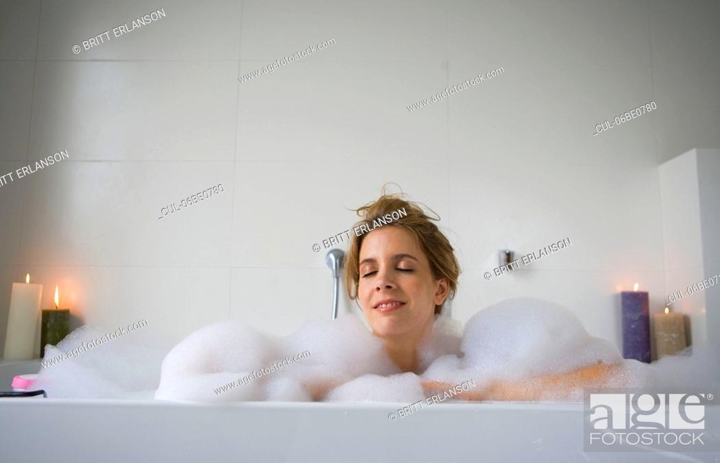 Stock Photo: Woman relaxing in bathtub.