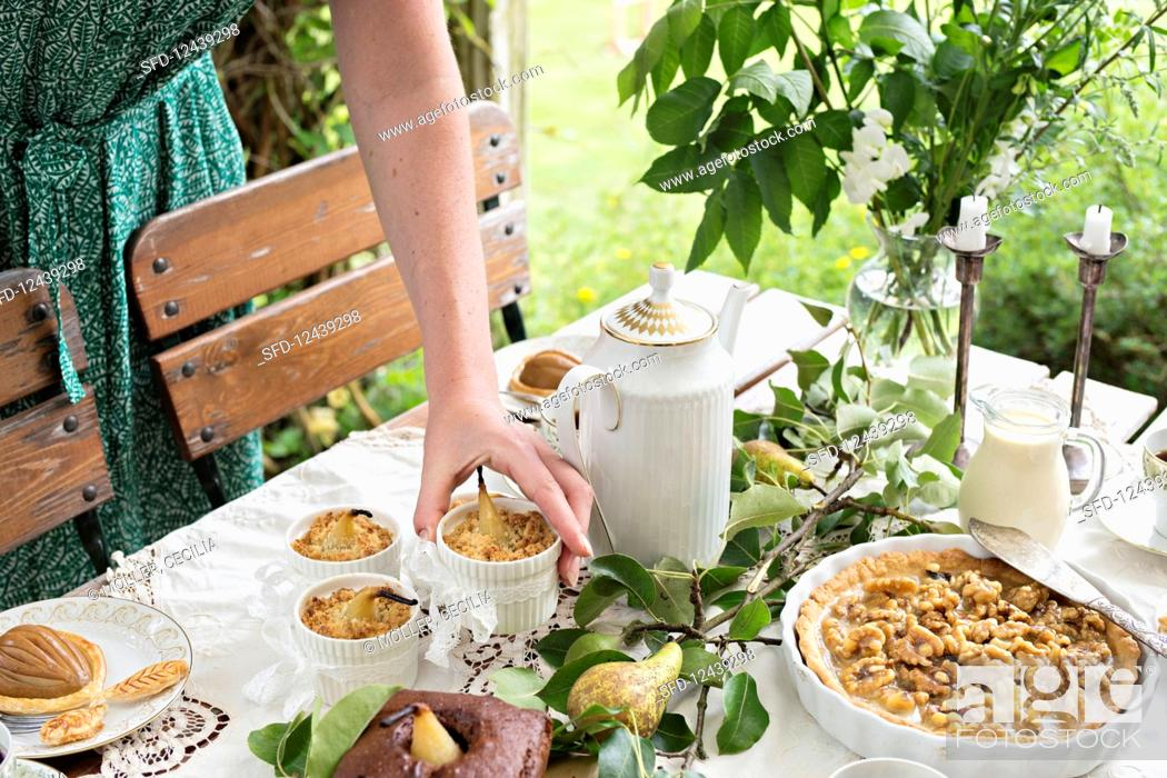 Photo de stock: A table laid with various pear cakes and desserts.