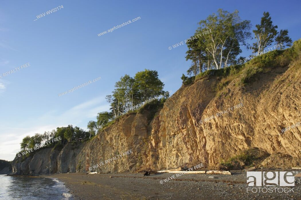 Stock Photo: View of cliff at sunset, New Richmond, Gaspesie, Quebec.