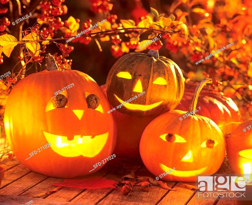 Stock Photo: Halloween: hollowed-out pumpkins at night.