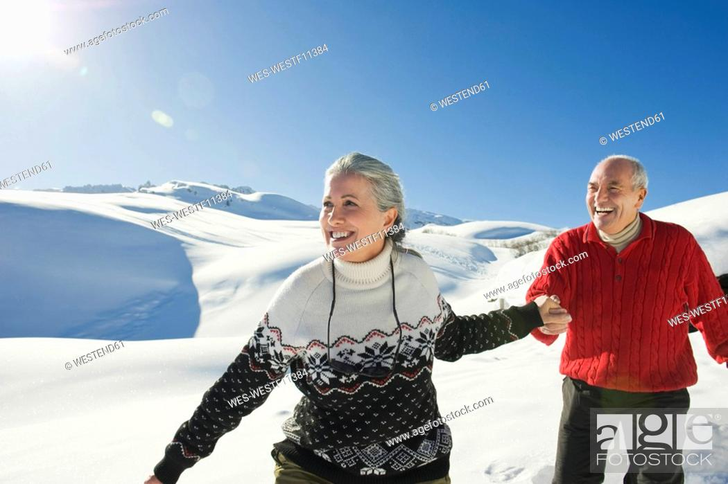 Stock Photo: Italy, South Tyrol, Seiseralm, Senior couple in winter scenery.