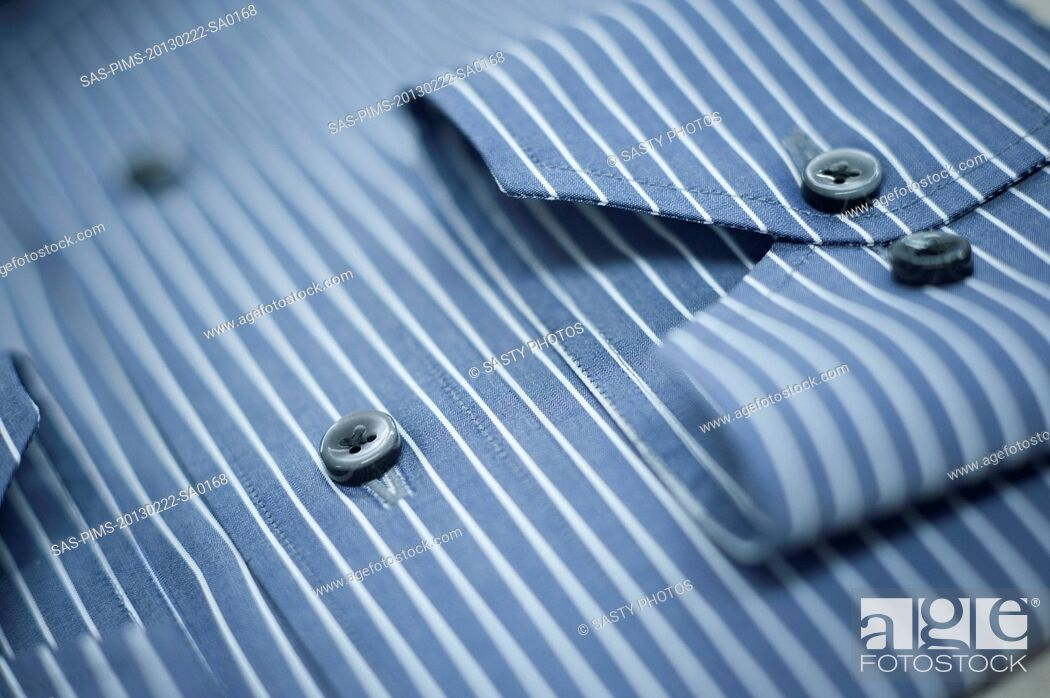 Stock Photo: Close-up of a button down shirt.
