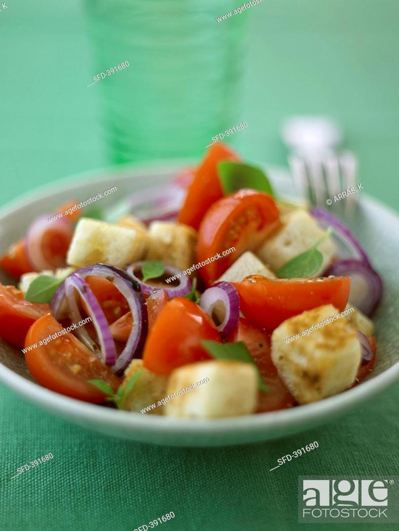 Stock Photo: Panzanella Bread salad with tomatoes and onions, Italy.