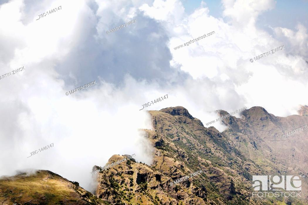 Stock Photo: Landscape in the Simien Mountains National Park  Clouds are moving up at the edge of the escarpment forming a dramatic background  The Simien Semien, Saemen.