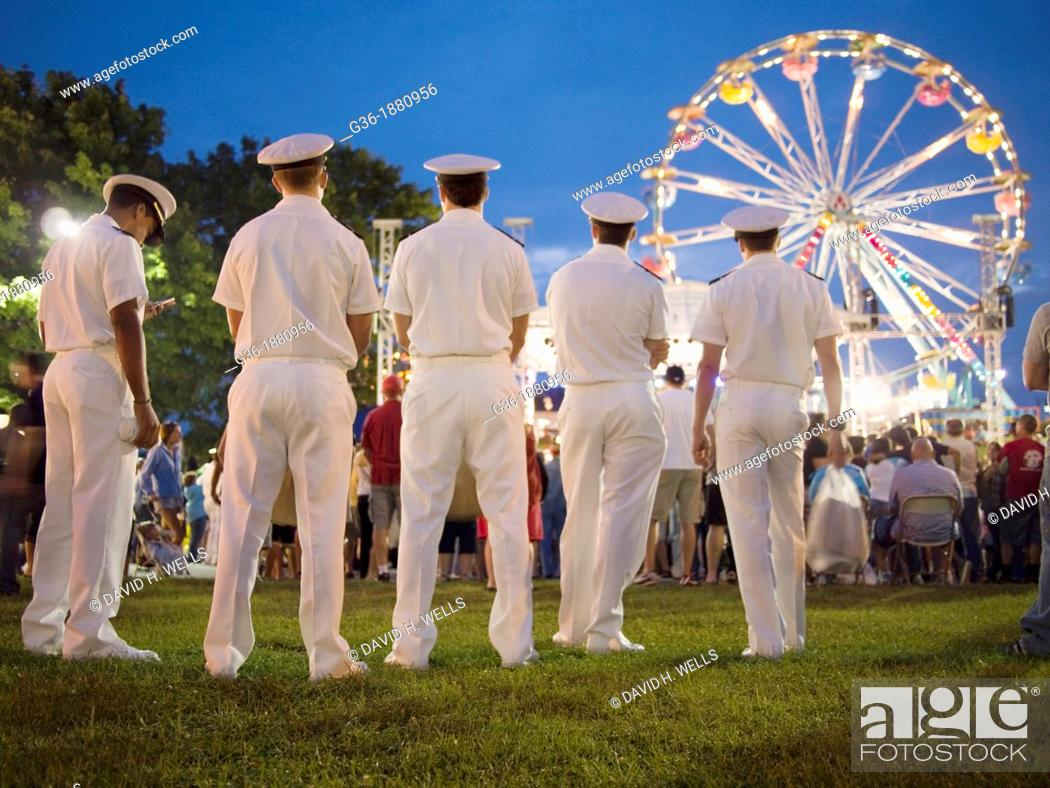 Stock Photo: U S  Navy sailors at the carnival at the Maine Lobster Festival in Rockland, Maine, United States.