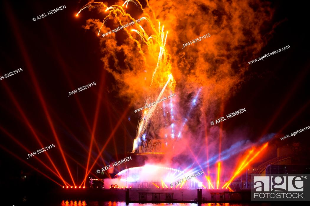 Fireworks sparkle above the new Stage Theater at the Elbe river in