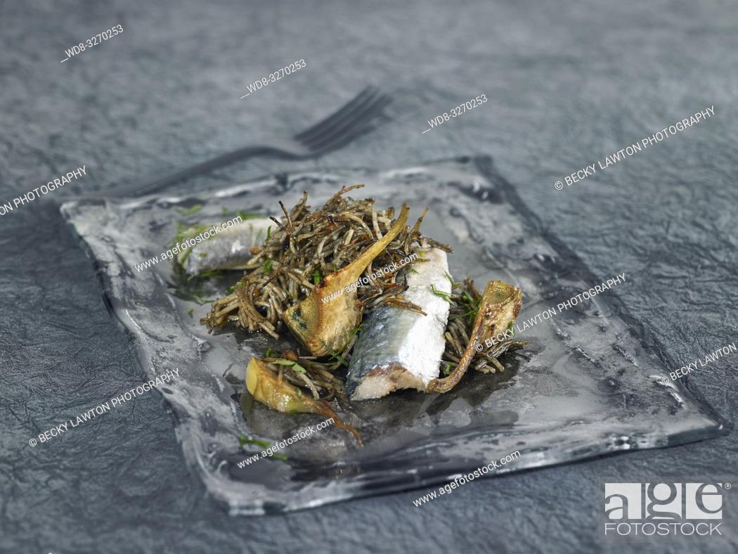 Stock Photo: fideos con sardinas, alcachofas y salsa romesco.