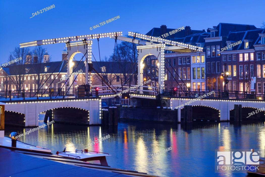 Stock Photo: Netherlands, Amsterdam, Magere Brug, the Skinny Bridge, dusk.