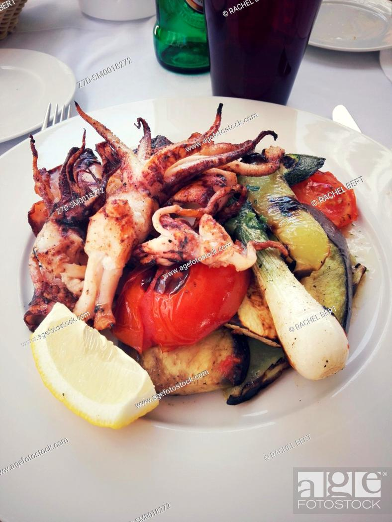Stock Photo: calamari with vegetables.