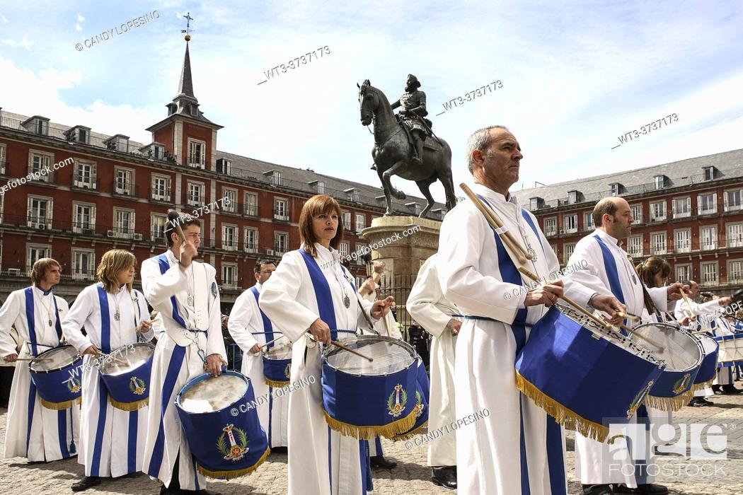 Stock Photo: Procession of Holy Week in Plaza Mayor square and equestrian estatue of Felipe III, MADRID, SPAIN, EUROPE.