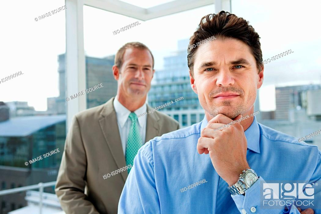 Stock Photo: Two businessmen in office, portrait.