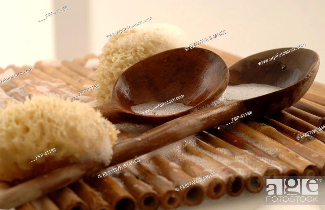 Stock Photo: Sponges and two wooden spoons.