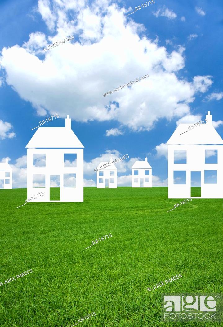 Stock Photo: Cut out houses in grass field.