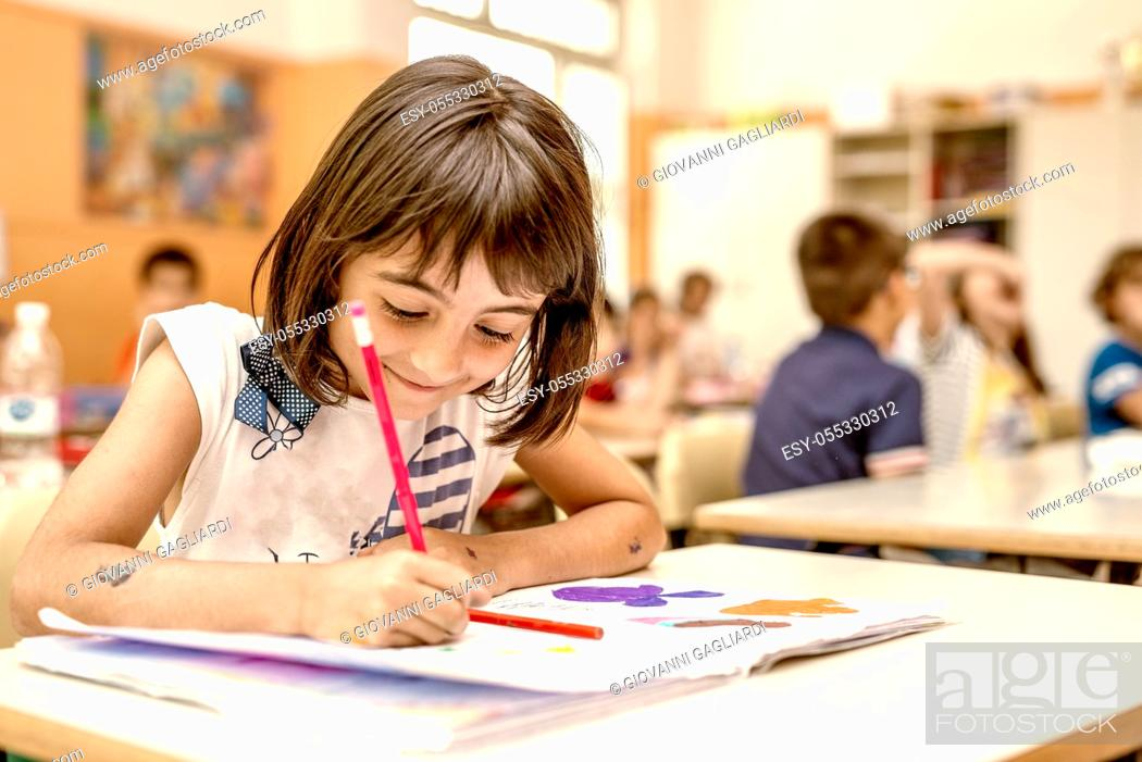 Photo de stock: Young girl on her first day of elementary school in the classroom.