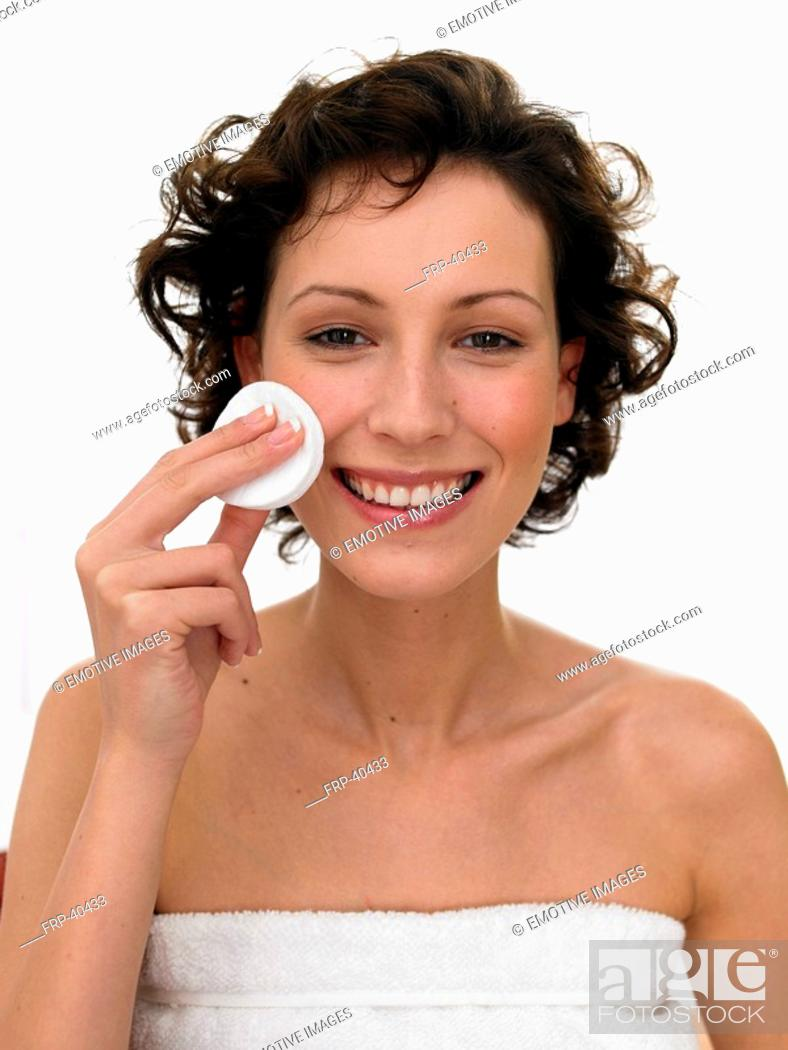 Stock Photo: Woman cleaning her face with dabber.