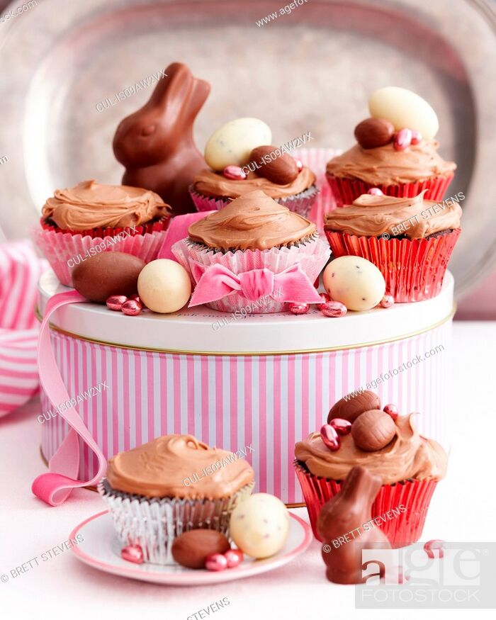 Stock Photo: Chocolate cupcakes covered with icing decorated with easter eggs.