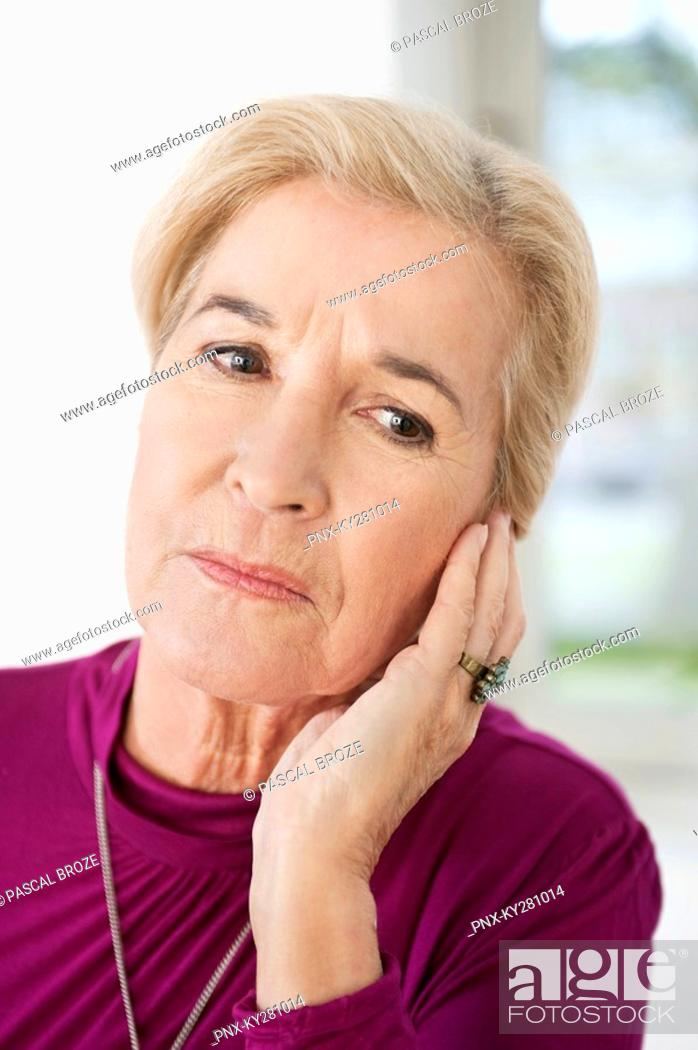 Stock Photo: Close-up of a woman suffering from a toothache.