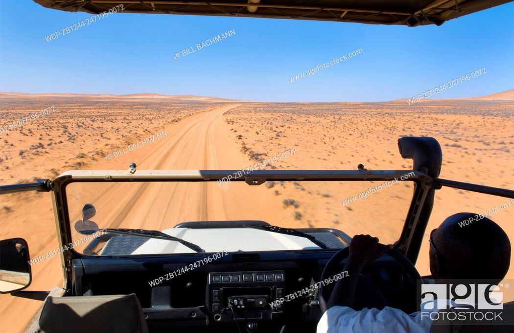 Imagen: Namibia Northern Desert of Namib Desert riding safari vehicle in sand dunes of Hartmann Berge deserted land Hartmann Valley Marienflub with hills and ripples.