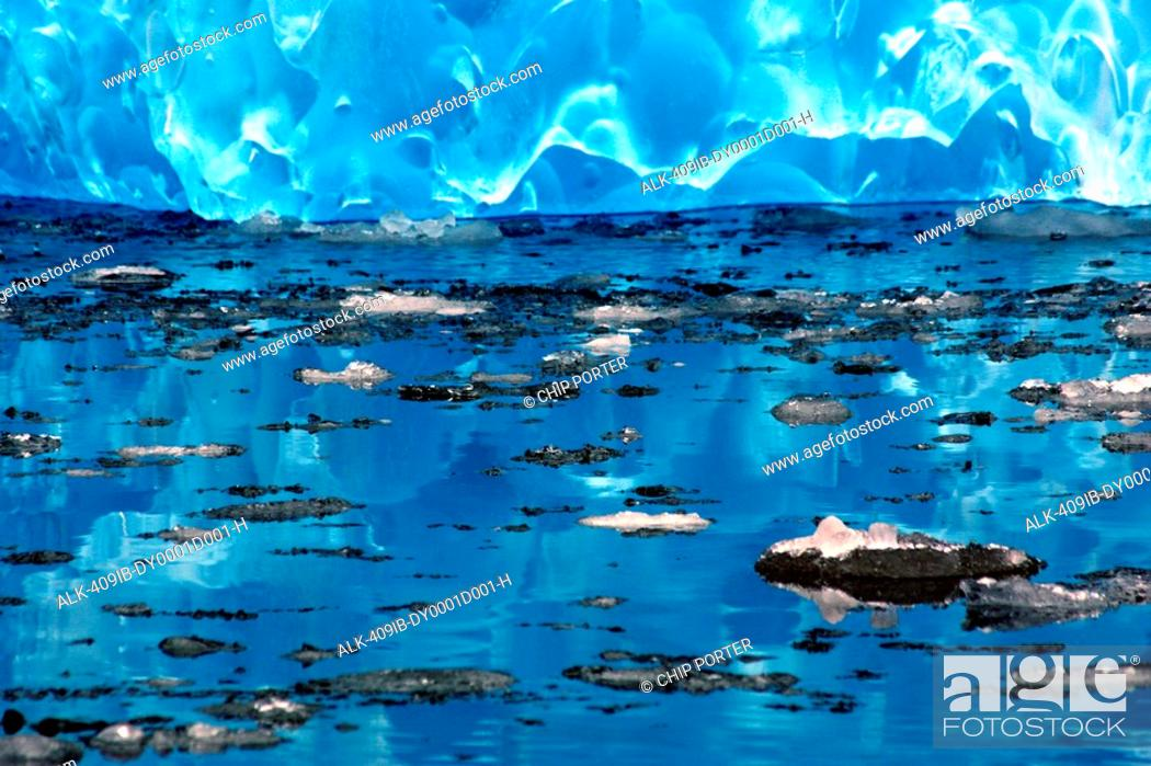 Stock Photo: Tiny pieces of ice float near an iceberg in LeConte Bay, Southeast, Alaska.