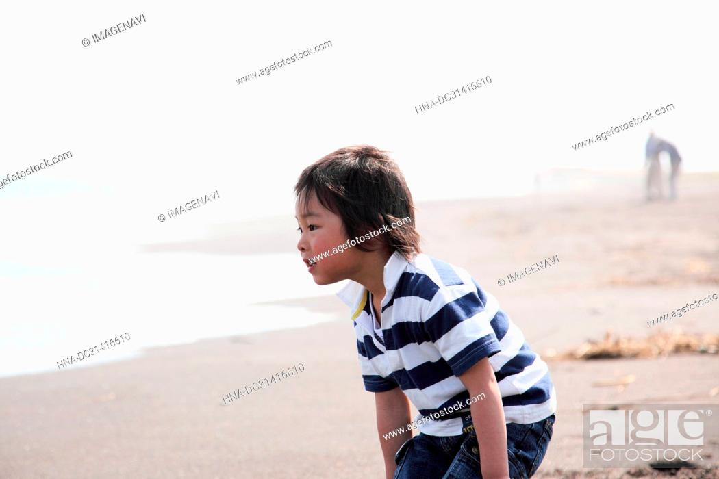 Stock Photo: Child playing at sea.