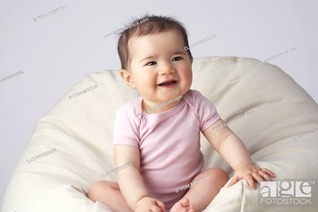 Stock Photo: A baby in a beanbag chair.