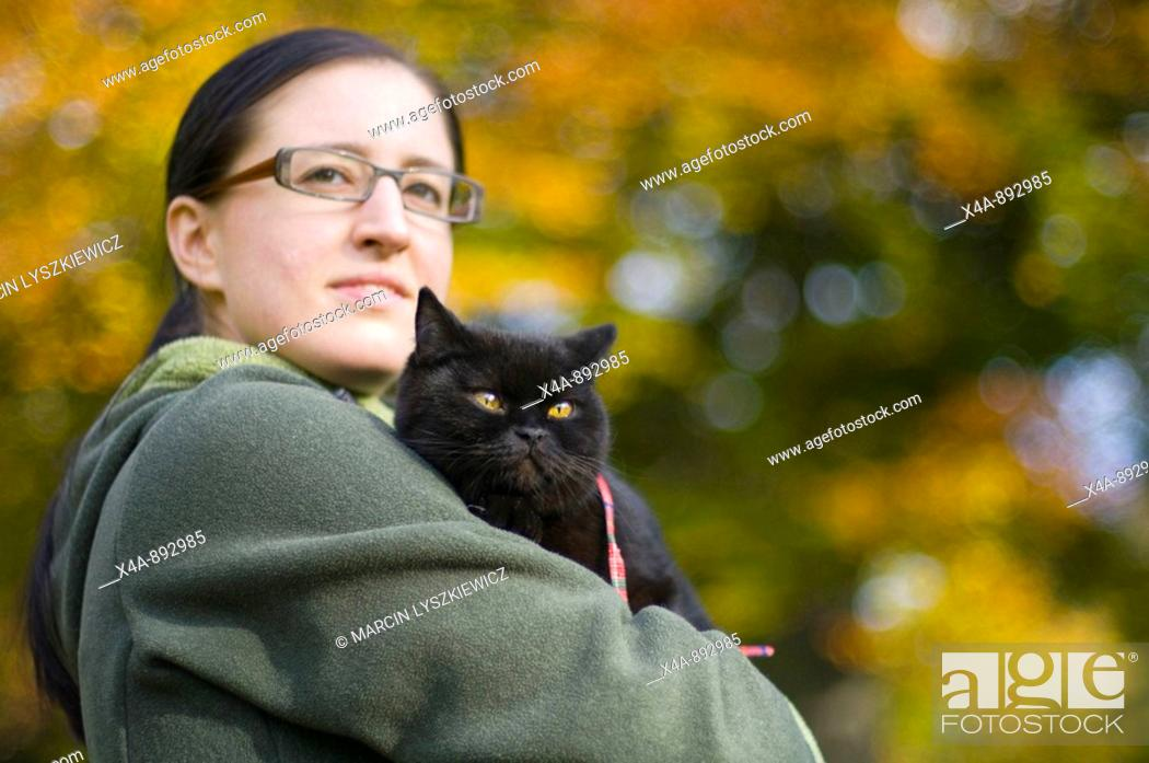 Stock Photo: Woman with British shorthair cat.