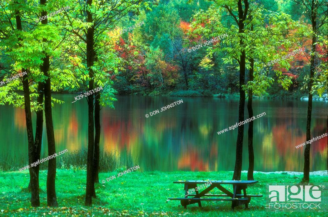 Stock Photo: Autumn colour reflected in Simon Lake, with picnic grounds, Naughton, Ontario, Canada.