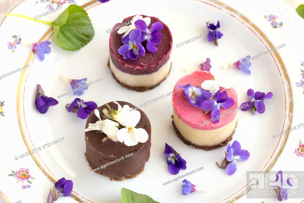 Stock Photo: Raw vegan desserts with fresh violet and lungwort flowers.