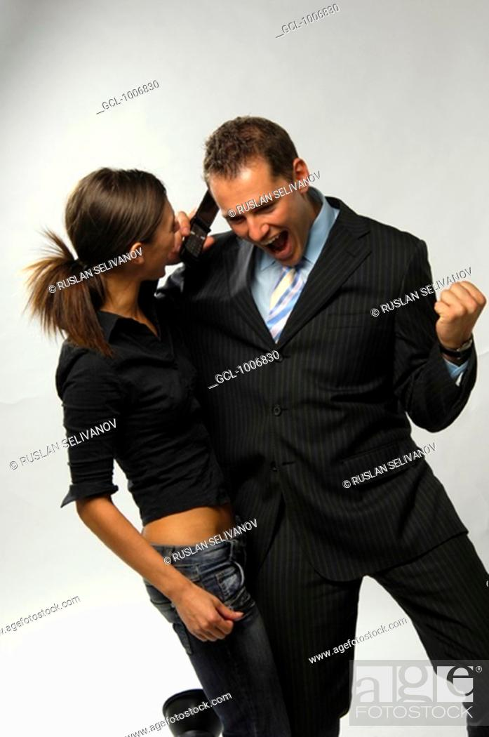 Stock Photo: Excited couple using mobile phone.