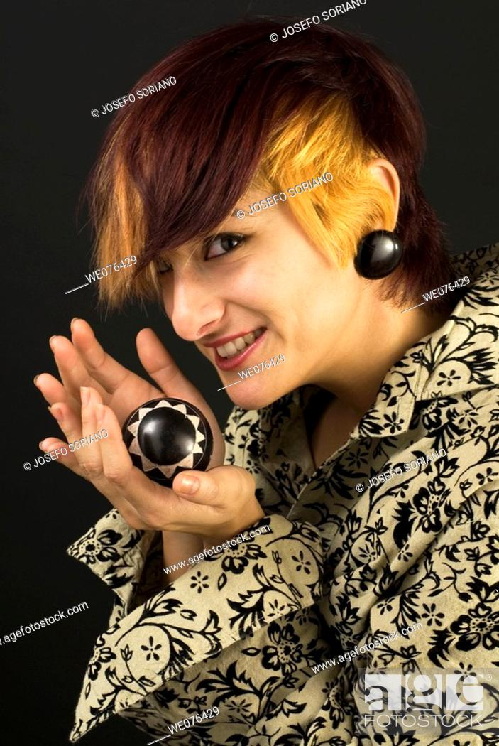 Stock Photo: Woman holding ball.