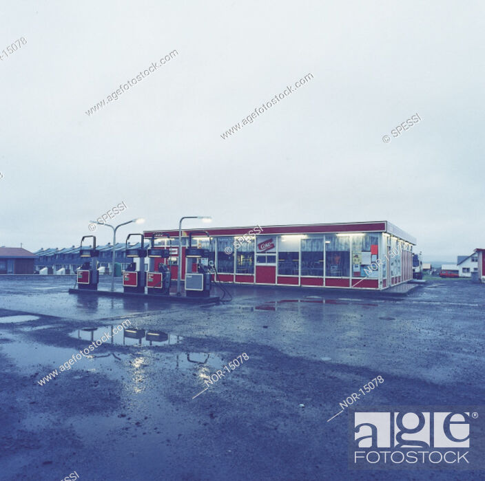 Stock Photo: A petrol station in a town in wet weather.