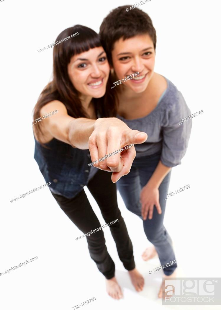 Stock Photo: Two women pointing.