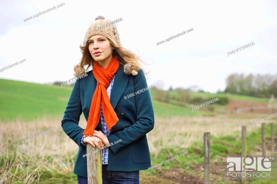 Stock Photo: Beautiful woman standing in a field.