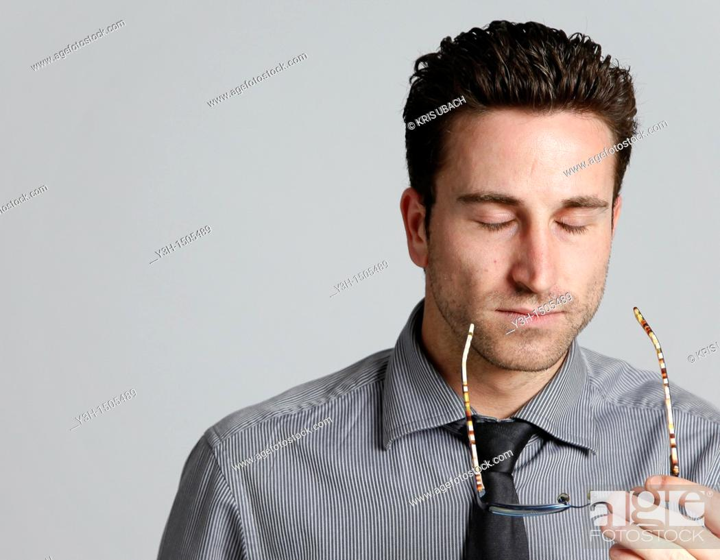 Stock Photo: Studio shot of man, stressed.