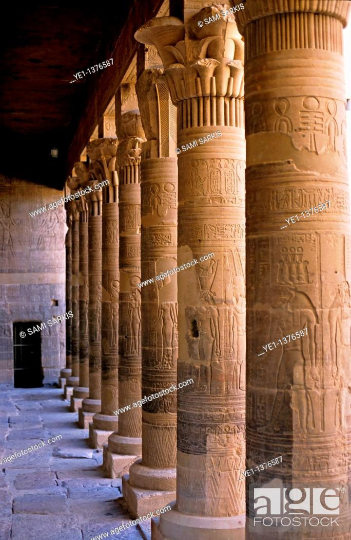 Stock Photo: Colonnade marking the entrance to the ancient remains of a temple for Isis on the island of Philae on the Nile river, Egypt.