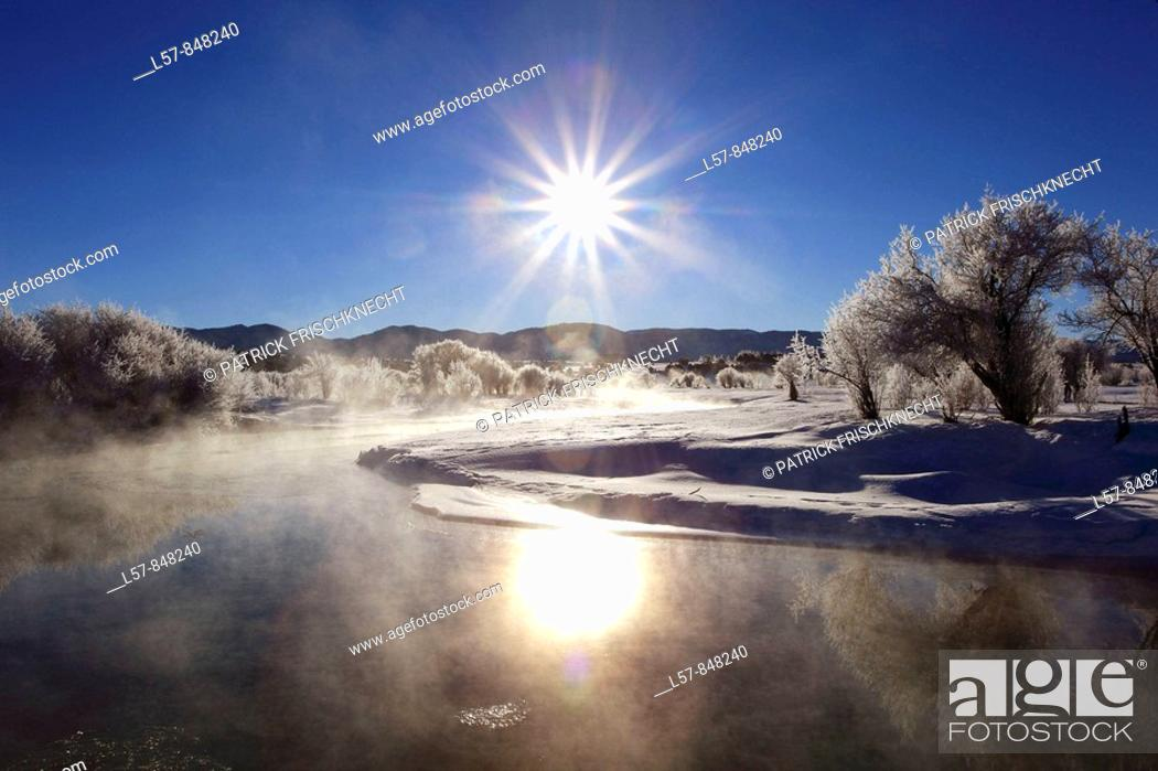 Stock Photo: Winter landscape with hoarfrost, steeming river, brilliant sunshine and blue sky, Utah, USA.