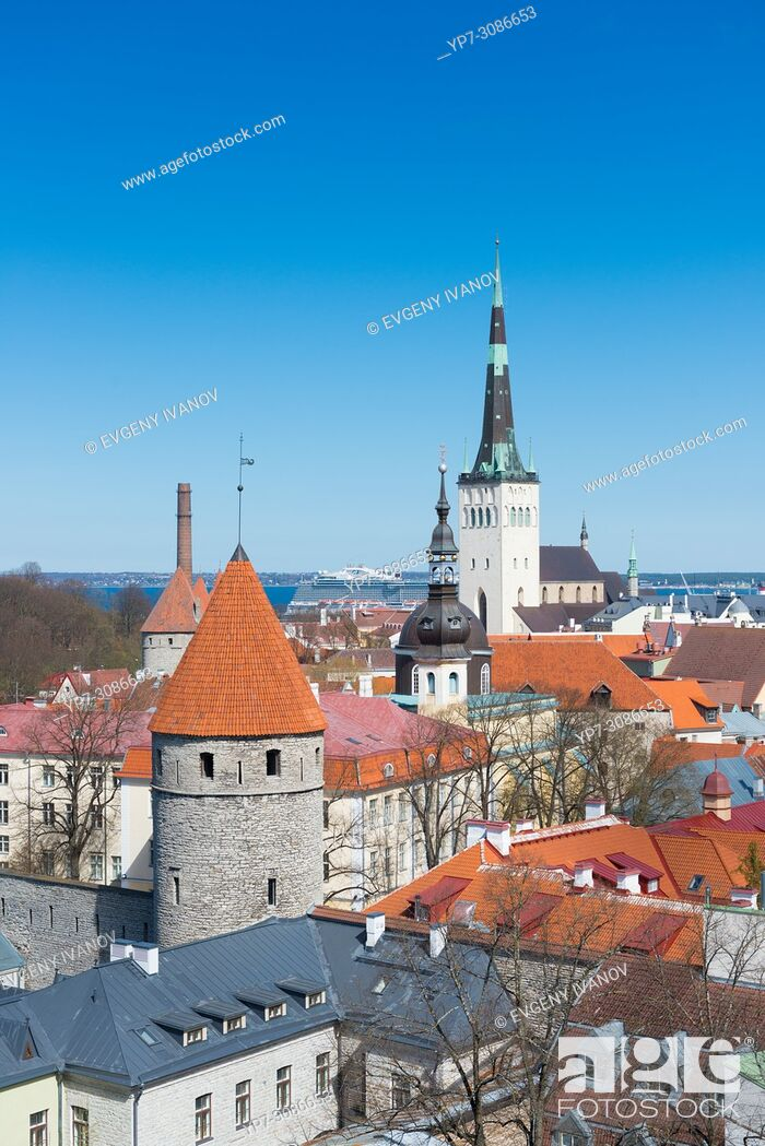 Stock Photo: Tallinn red roofs, towers and Oleviste church.