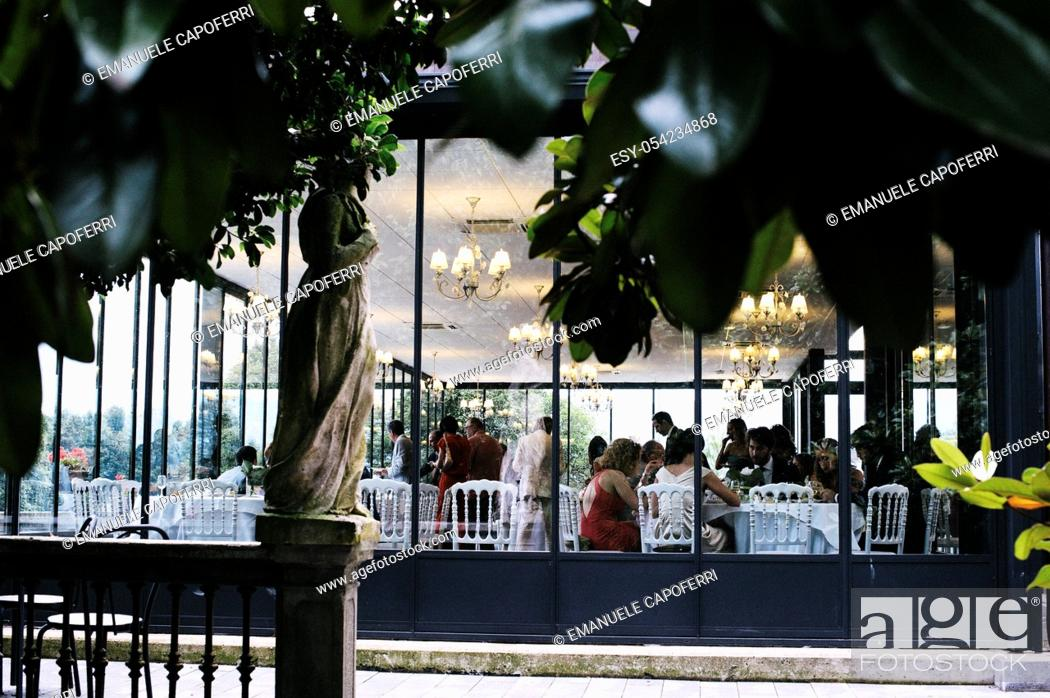 Stock Photo: Garden of ancient Italian villa view of Limonaia while a reception is in progress.