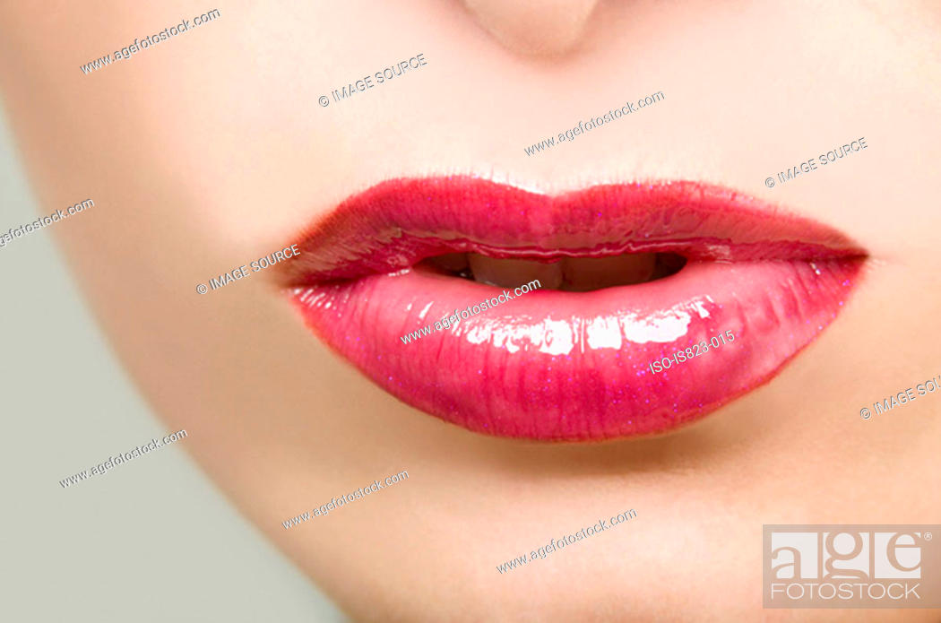 Stock Photo: Woman wearing pink lipstick.