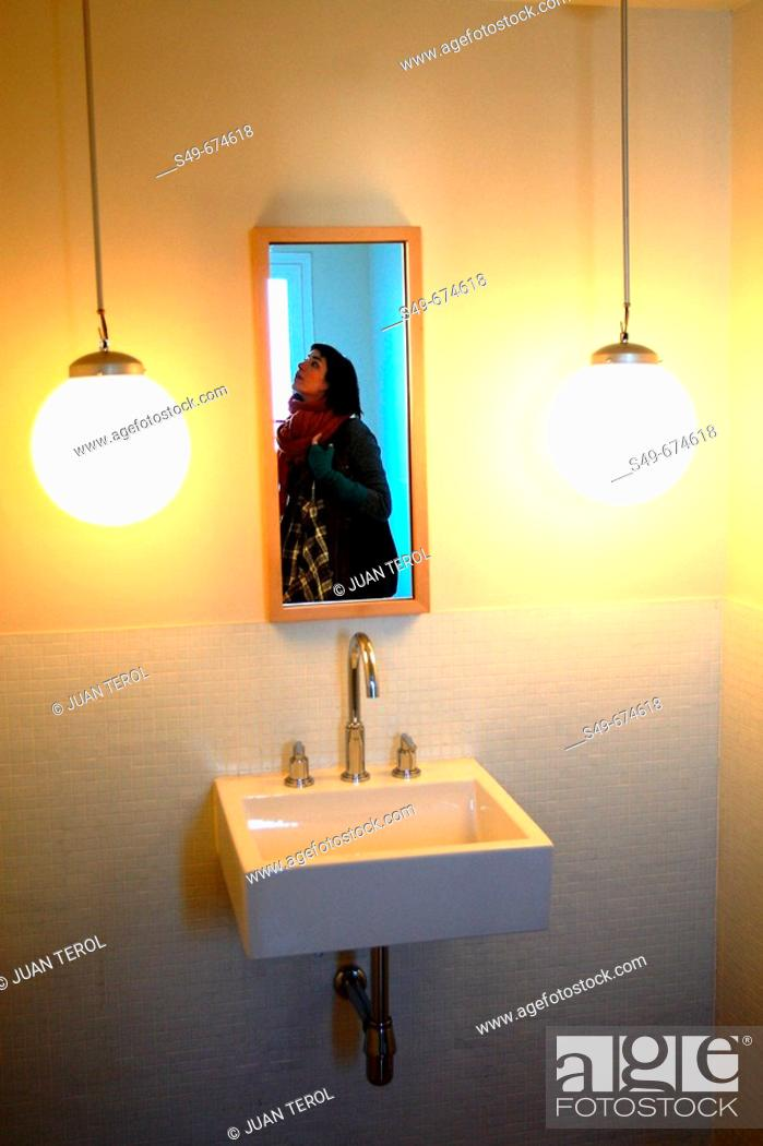 Stock Photo: Portrait of a woman in the hotel bathroom, Madrid. Spain.
