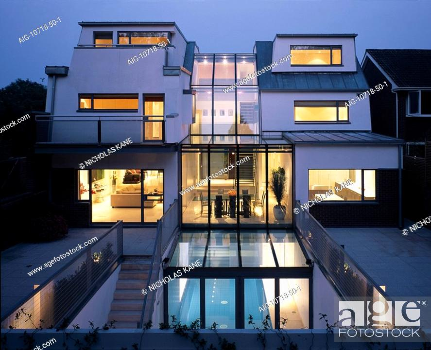 basement pool house. Stock Photo - Modern House With Basement Pool, Hampstead Exterior View Rear Facade Swimming Pool At Night. Architect: Belsize Architects