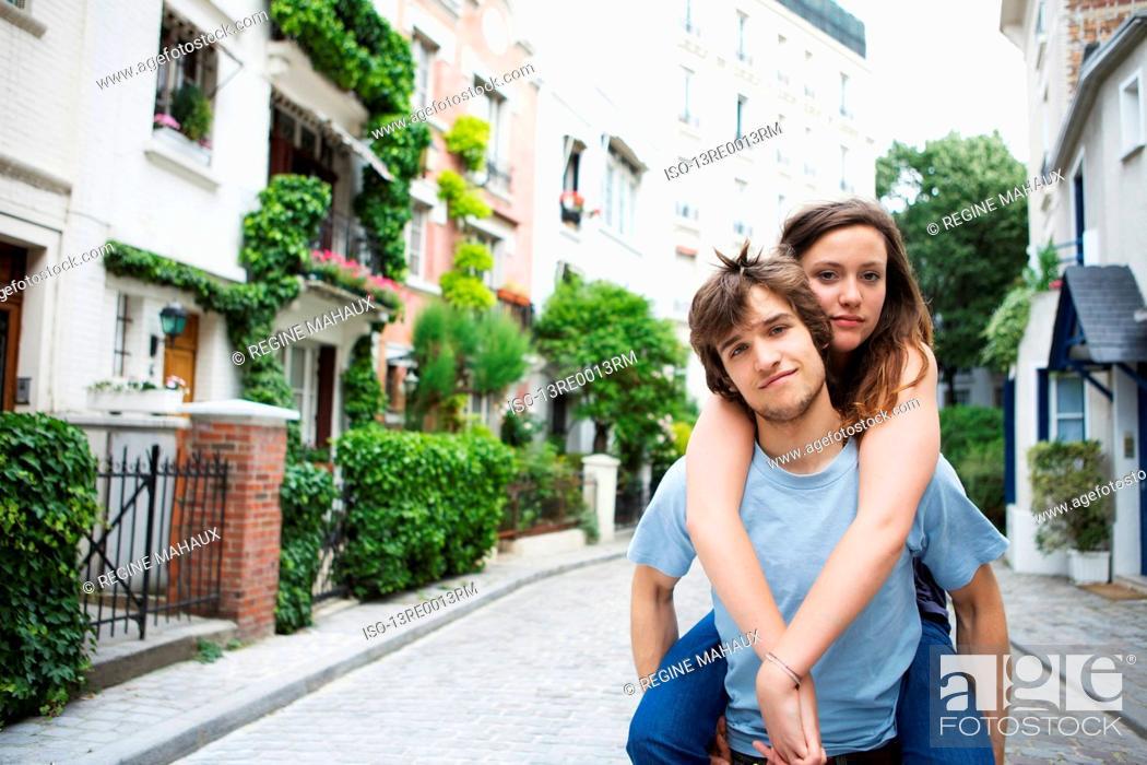 Stock Photo: Boy and girl having fun on street.